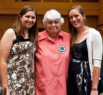 Anna Gutekunst presents UF Health Shands Hospital Auxiliary scholarships to Ashley-Marie Bodor and Kathryn Swanson at the college's 2012 convocation ceremony.